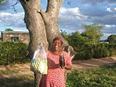 Lizzy Shibambu proudly shows the fruit of the marula tree and jam made from it. © Constance Rahlane